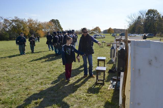 Sean Peterson, 9, and Christine Hogan of Mattituck explore the Civil War encampment.