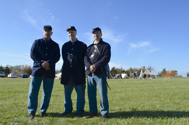 Civil War reenactors Tom Badamo, left, Tom Demaria and Tim MaGee at their camp.