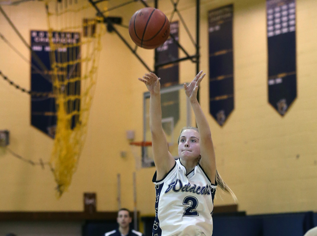 Shoreham-Wading River senior Courtney Clasen shoots a jumper in a game last month. (Credit: Daniel De Mato)