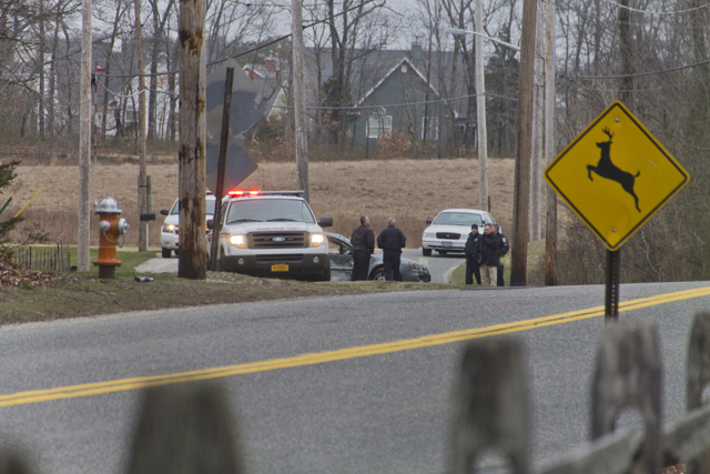 Police investigate the scene of a one-car accident Thursday afternoon on Middle Road. (Credit: Paul Squire)