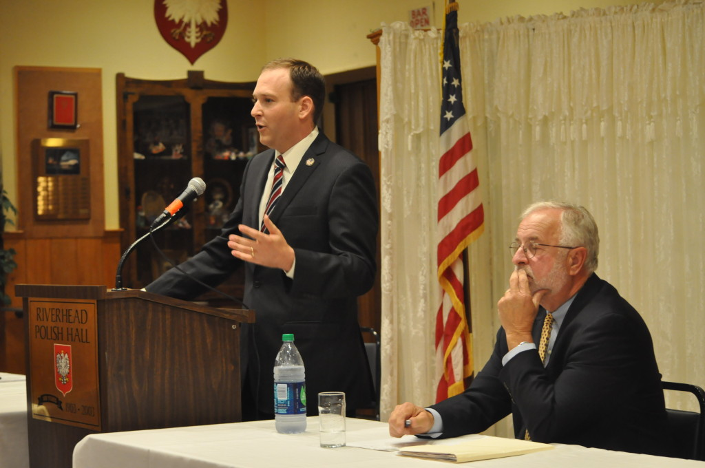 State Senator Lee Zeldin (left) and Congressman Tim Bishop (right) took turns a podium in Polish Hall to address questions Wednesday night in Riverhead.