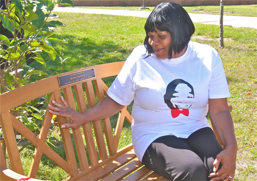 BARBARAELLEN KOCH CAPTION | Demitri Hampton's mother, Juanita Trent, sits on a bench dedicated to her son, who was killed earlier this year.