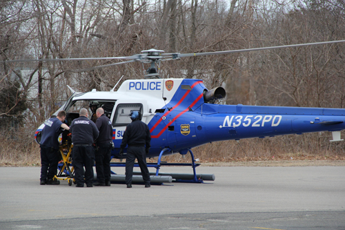 CARRIE MILLER PHOTO | Medical workers load a dirt bike crash victim into a Medevac helicopter Thursday afternoon.