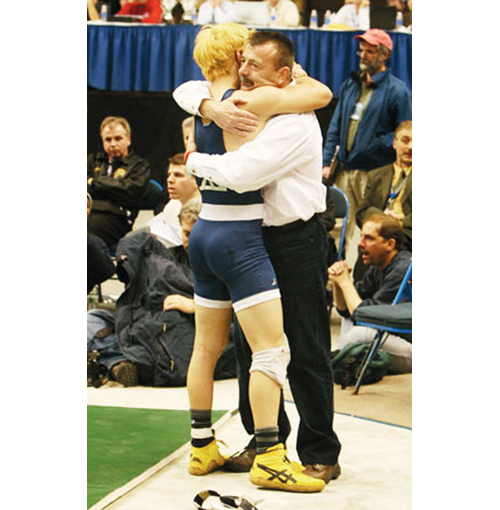 Don Jantzen hugs his son Corey after the finals of the 2007 state championship in Albany. Don retired as Shoreham-Wading River's head coach after that season, which ended with Corey winning a second state title. (Credit: Peter Blasl, file)