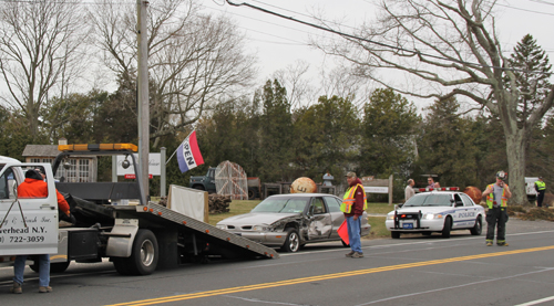 The female driver of a tan Oldsmobile was arrested after swerving into the westbound lane on Main Road in Jamesport.  (Credit: Carrie Miller)
