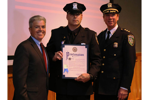 Suffolk County Executive Steve Bellone, Riverhead Police Officer Timothy Murphy and Chief David Hegermiller (Credit: Courtesy photo)