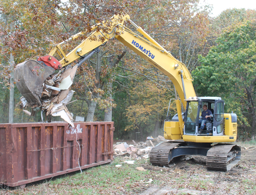 PAUL SQUIRE FILE PHOTO | An excavator clears debris during demolitions on Horton Avenue last fall.