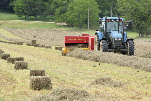 BARBARAELLEN KOCH FILE PHOTO | Aquebogue farmer Donald McKay cutting a field of hay on Sound Avenue in Riverhead.