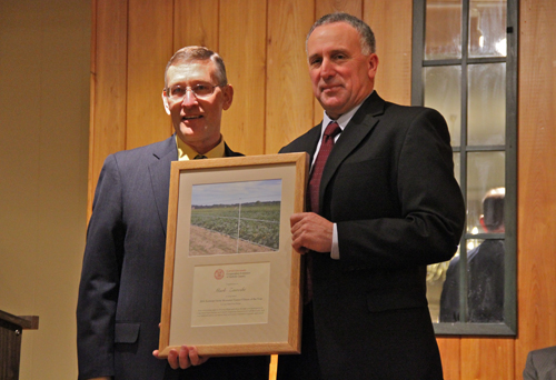 Cornell Cooperative of Suffolk County Agriculture Program director Dale Moyer honoring Mark Zaweski  (Credit: Carrie Miller)