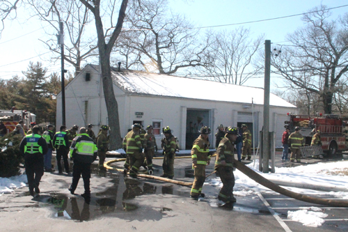 PAUL SQUIRE PHOTO | Riverhead firefighters at the scene of Sunday afternoon's fire.