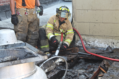 STEVE ROSSIN PHOTO | Riverhead firefighters put out a fire on the roof of Cliff's Rezdezvous in Riverhead.