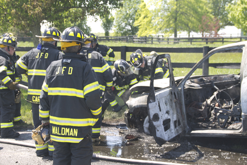 Jamesport firefighters put out a fire in a Dodge pickup truck around noon Tuesday on Manor Lane in Jamesport. (Credit: Grant Parpan)