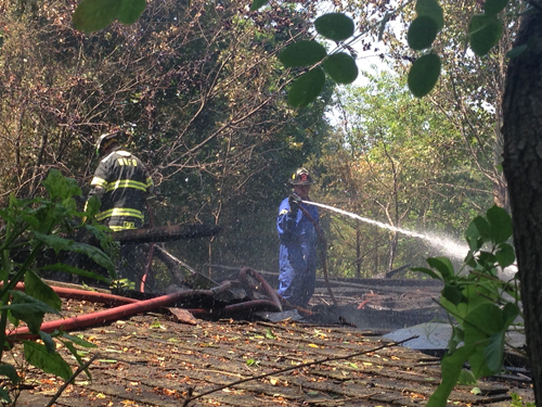Fire crews put out a fire at an abandoned barn this afternoon in Calverton. (Credit: Paul Squire)