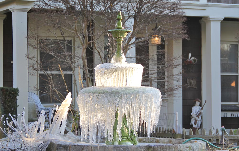 More ice than water could be seen on one Main Road fountain Wednesday. (Credit: Carrie Miller)