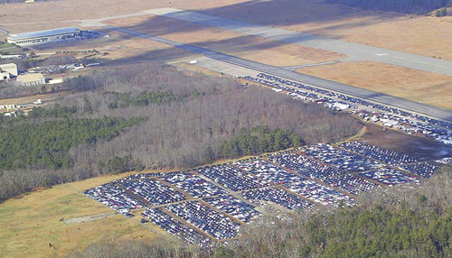 DEC COURTESY PHOTO |  Sandy-damaged cars parked on grasslands at EPCAL in early January.
