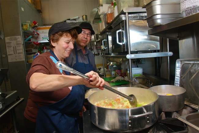 Ioanna and Manolis Kavvadias cooking up vegetables for soup Friday morning at Greek Bites Grill in Mattituck. (Credit: Barbaraellen Koch)