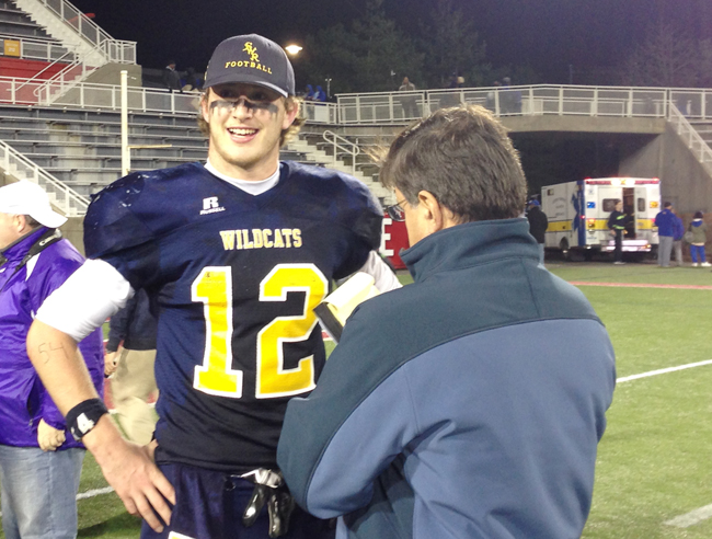 Newsday sportswriter Bob Herzog interviews Shoreham-Wading River quarterback Danny Hughes after the Wildcats won the Long Island Championship in November. (Credit: Joe Werkmeister)