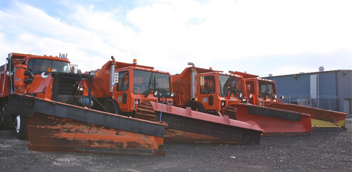 FILE PHOTO | Plow trucks at the Osborn Avenue highway department yard.