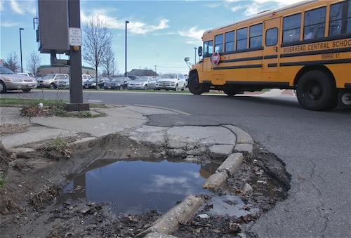 A pothole that developed on the corner of Court Street and Osborn Avenue is raising eyebrows. (Credit: Barbraellen Koch)