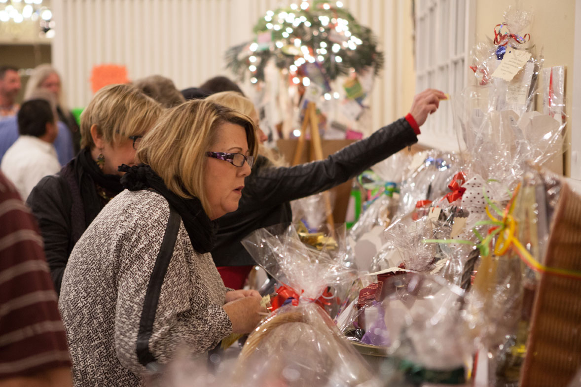 A woman checks out some of the dozens of Chinese auction prizes.