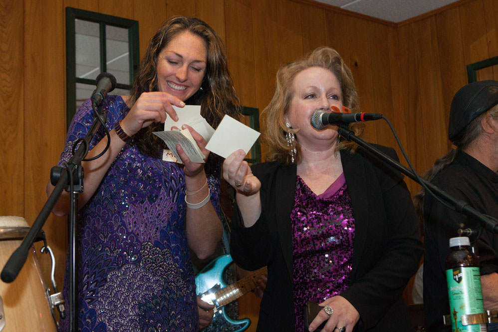 Melissa Ludlow and host Lisa Dabrowski call out the raffle winners.
