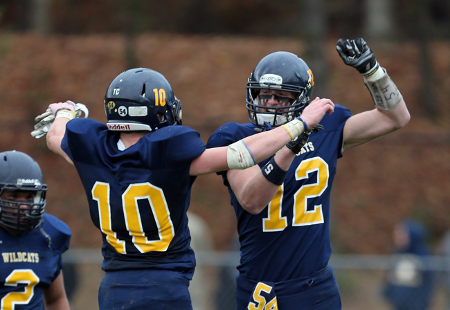 Shoreham-Wading River seniors Christian Clarkin (10) and Daniel Hughes celebrate during their victory over Port Jefferson. (Credit: Daniel De Mato)
