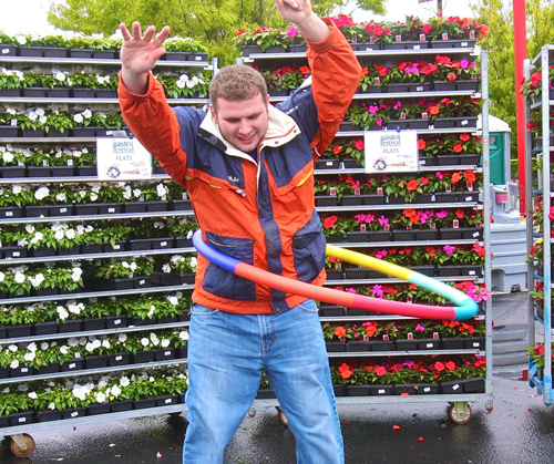 PBMC Health grant writer Max Comando of Jamesport, 24,  tests out the weighted Hula Hoops that will be used Saturday for the kids contest at the Garden Festival from 1 p.m. to 3 p.m. at the Staples Shopping Center on Route 58 in Riverhead.