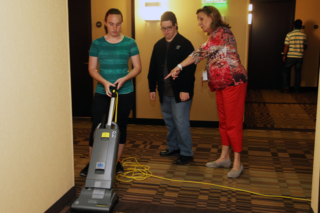 From left to right, Jessica Stimpfel, David Siletti and Transition Program Director Elva Beyer working at the Hyatt Hotel. (Credit: Courtesy)
