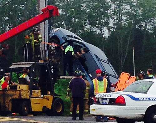 Firefighters work to rescue a woman who became trapped on Route 58 Friday morning (Credit: Cyndi Murray photo)
