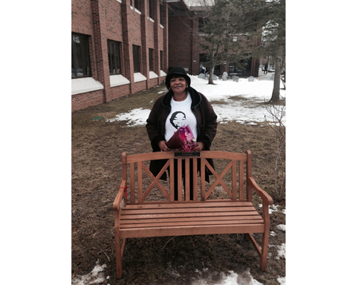 COURTESY PHOTO | Juanita Trent, Demitri Hampton's mother, at a bench dedicated in his honor on the campus of Suffolk County Community College.