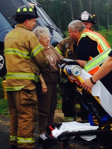 Firefighters check the driver for injuries after freeing her from her minivan Friday morning. (Credit: Cyndi Murray)