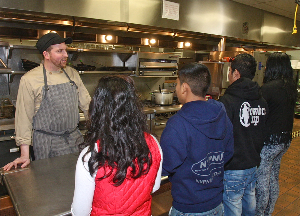 Culinary instructor Eric Rickmers talk to the new students in the commercial kitchen Monday afternoon. (Credit: Barbaraellen Koch)