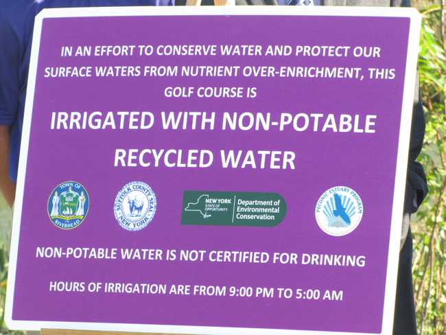 signs at Indian Island golf course describe the program to use treated sewer effluent as irrigation on the course. Tim Gannon photo.