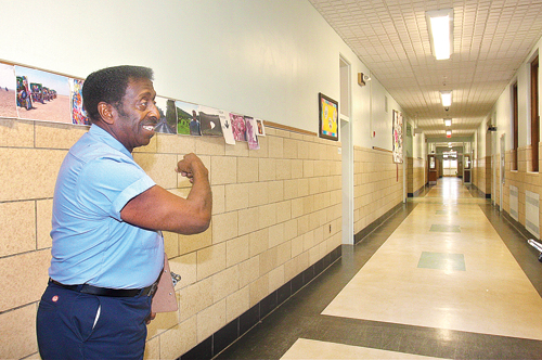 BARBARAELLEN KOCH PHOTO | Head custodian Carl James in the hallway of Pulaski Street Elementary School, where he started working almost 54 years ago.