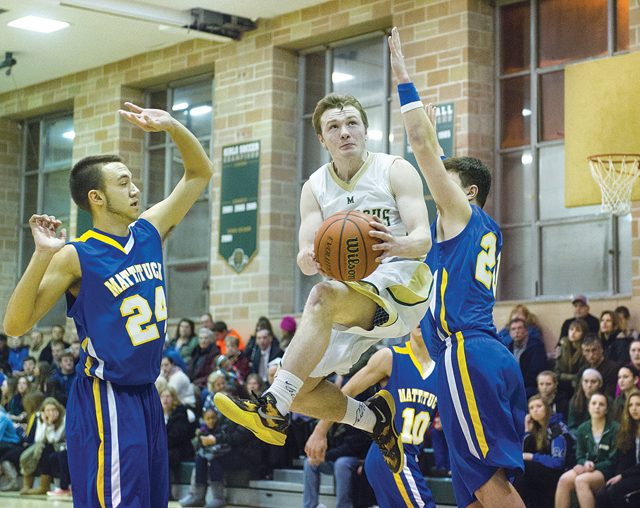 Bishop McGann-Mercy guard Joe Jeski drives to the basket against Mattituck last year. (Credit: Robert O'Rourk, file)