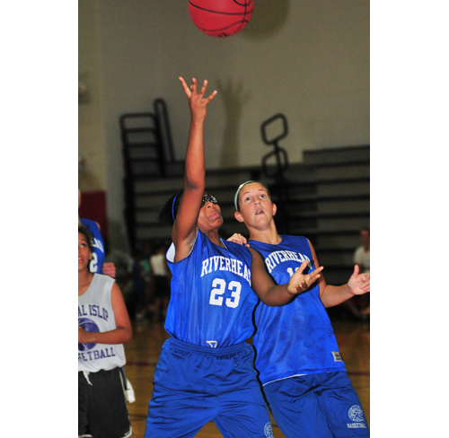Riverhead freshman Faith Johnson-DeSilvia goes up for a basket Monday against Central Islip. (Credit: Bill Landon)