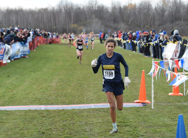 Shoreham-Wading River freshman Katherine Lee, pictured at the state meet Nov. 15, finished fifth Saturday in the federation championship race. (Credit: Kyle Brazeil/MileSplit NY)