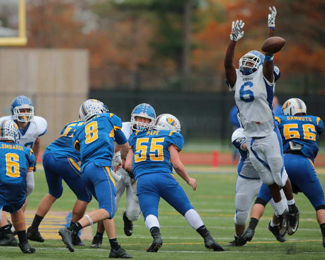 Riverhead's Tyrese Kerr blocks a pass from West Islip's Conor Smith in the third quarter. (Credit: Daniel De Mato)