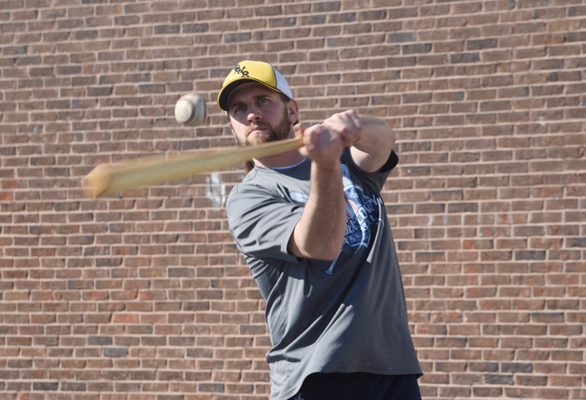 Shoreham-Wading River coach Kevin Willi hits fly balls Monday on the team's first day of official practices. (Credit: Robert O'Rourk)
