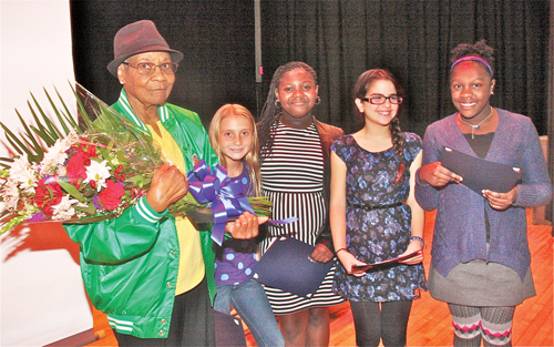 BARBARAELLEN KOCH PHOTO Medal of Honor recipient Pfc. Garfield M. Langhorn's mother Mary Langhorn with this year's essay contest winners Pulaski Street sixth graders (from left) Christine Thomas, Laniece Hutley, Nina Geraci and honorable mentio Summer Scott.