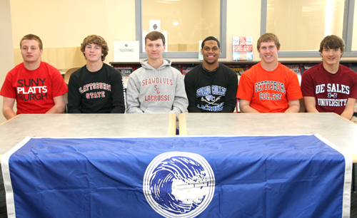 Six Riverhead athletes will continue playing their sports in college next year. At a signing ceremony Tuesday, (from left) Mike Van Bommel, Ryan Hubbard, Daniel Czelatka, Jaron Greenidge, Ryan Harkin and Tim Vail were honored. (Credit: Riverhead School District)
