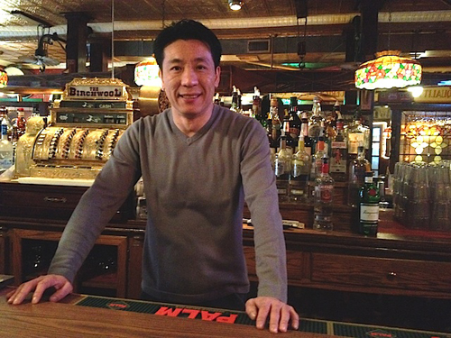 Ken Loo behind the bar at Birchwood on Pulaski Street in Polish Town. (Credit: Vera Chinese, file)
