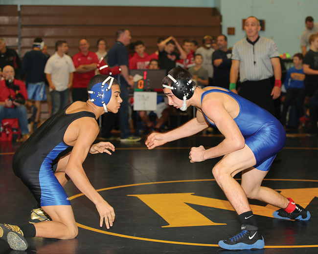 Riverhead senior Ed Matyka (right), pictured at the North Fork Invitational last year, is second-ranked in the county this season at 120. (Credit: Daniel De Mato, file)