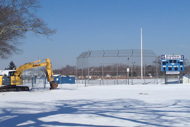 The rough winter left McKillop Field covered in snow, which has finally begun to melt, delaying the sod installation as the field undergoes renovations. (Credit: Joe Werkmeister)