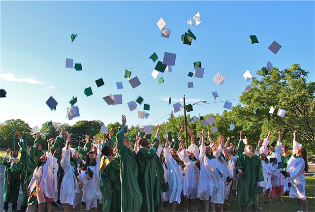 Mercy grads toss their caps. (Credit: Robin Bay)