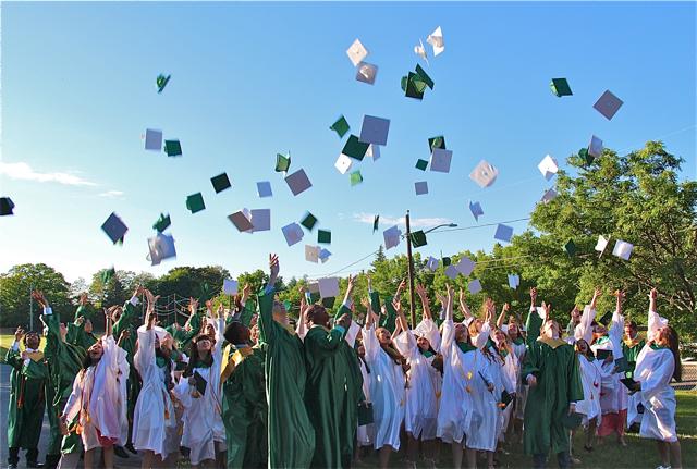 Mercy grads toss their caps. (Credit: Robin Bay)