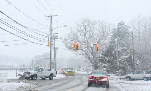 Riverhead Town plows on Middle Road Monday afternoon. (Barbaraellen Koch Photo)
