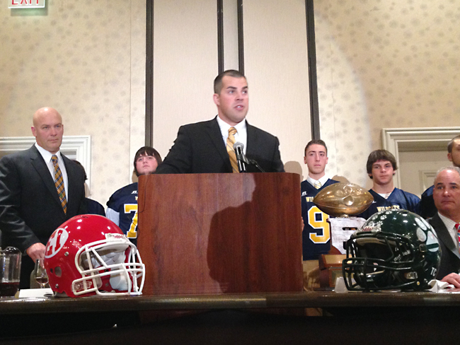 Shoreham-Wading River coach Matt Millheiser accepts the Rutgers Trophy on the team's behalf at Monday night's all-county dinner. (Credit: Joe Werkmeister)