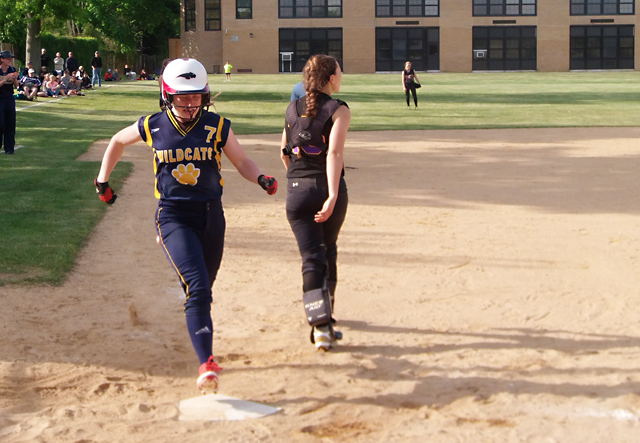 Shoreham-Wading River senior Caitlin Mirabell crosses home plate after hitting a home run in the sixth inning Friday. (Credit: Joe Werkmeister)