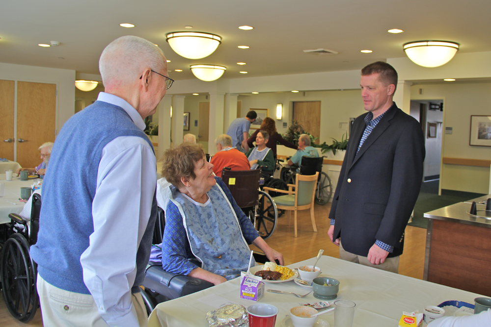 Supervisor Scott Russell (right) speaks with San Simeon resident Barbara Yagle, 75, and her husband Jim, 79 of Cutchogue, who stopped to have lunch with his wife.